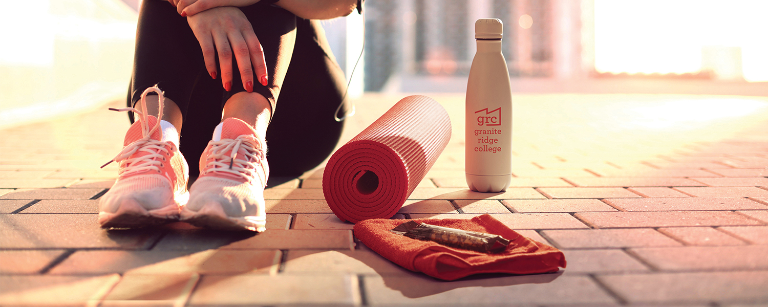 Health and fitness gift box with yoga mat, towel, water bottle and earbuds