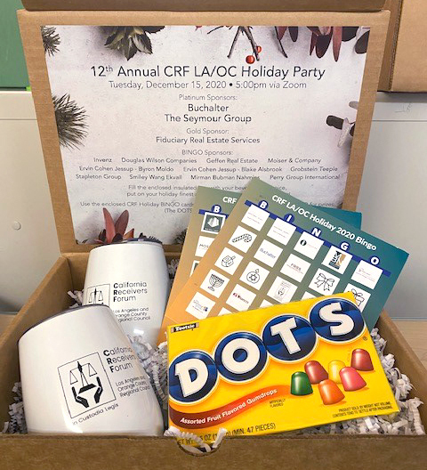 JBS and Associates virtual event gift box including wine glasses, bingo card, and DOTS candy