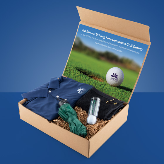 Gift box with golf balls, umbrella, polo and golf towels