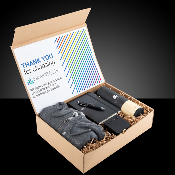 Gift box with sweater, journal, pen, thermos and speaker