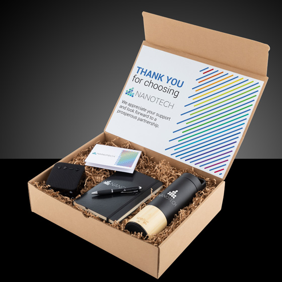 Gift box with water bottle, notebook, pen, speaker and custom note card