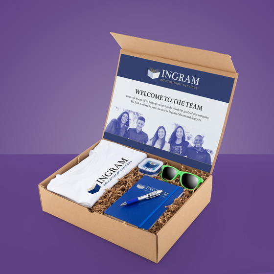 Gift box with shirt, journal, pen, sunglasses and ear buds